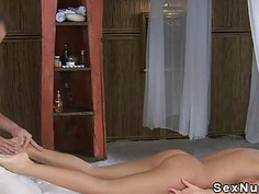 Slim brunette gets erotic foot massage