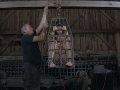 Sasha sits in the tiny cage and blows a dick of a mature BDSM freak