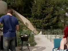 Swingers enjoying outdoor party in reality show