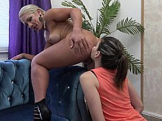 Lesbian babe licking out her brazilian friend's ass